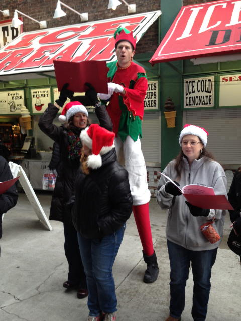 Stilt guy at Christmas at Fenway